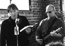 John reads aloud with Dirk Sutro playing guitar